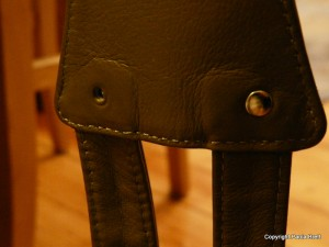 Missing a rivet in the handbag strap